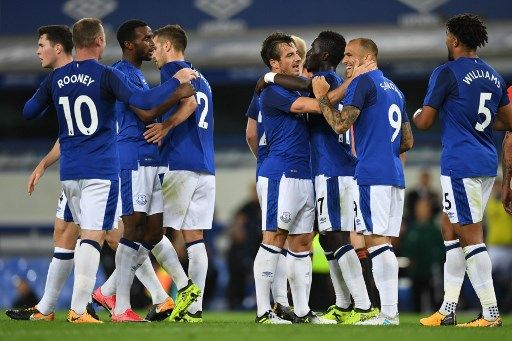 Everton's English defender Leighton Baines (4R) celebrates, with teammates, scoring the first goal during the UEFA Europa League third qualifying round, Game 1 match between Everton and Ruzomberok at Goodison Park football stadium in Liverpool on July 27, 2017. / AFP PHOTO / Paul ELLIS
